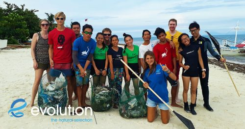 Beach clean up after Tropical Storm Urduja evolution diving resort philippines